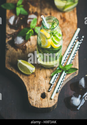 Citrus fruit and herbs infused sassi water on wooden board - Stock Photo