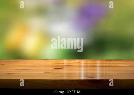 blurred springbackground with wooden desk - Stock Photo