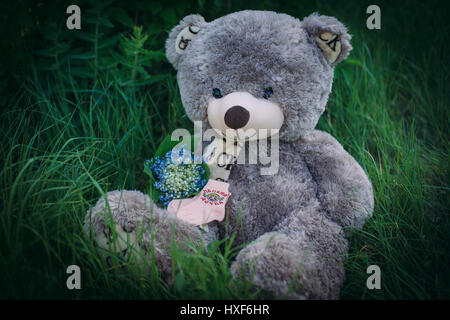 booties and teddy bear - Stock Photo