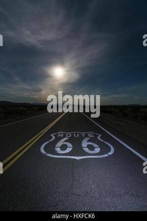 Desert moon over Route 66 sign in eastern San Bernardino County, California. - Stock Photo
