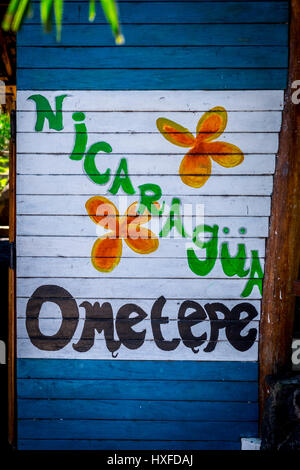 A cheerful Ometepe sign with the Nicaraguan Flag background, Isla Ometepe, Nicaragua - Stock Photo