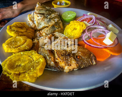A traditional plate of fried mojarra (fish) from Lake Nicaragua - Stock Photo
