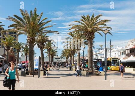 Shoppers and tourists in Moseley square at Adelaide's beachside suburb of Glenelg, South Australia - Stock Photo