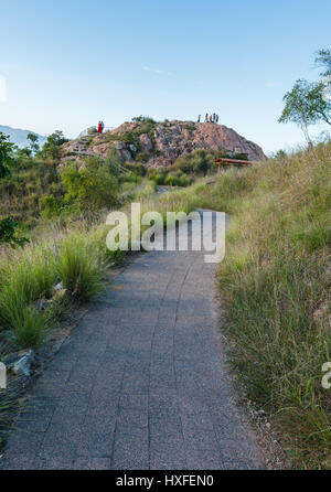 People standing on top of rocky hilltop on Castle Hill, Townsville, Australia - Stock Photo