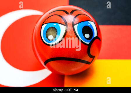 Flags of Germany and Turkey with Schlechter-Laune-Smiley, crisis in the German Turkish relations, Fahnen von Deutschland - Stock Photo