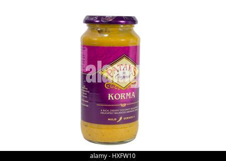 Pataks korma sauce in 450g jar. Isolated on white. - Stock Photo