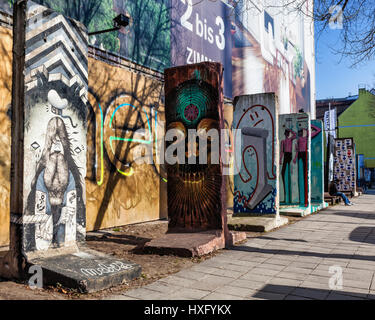 Colourful Berlin Wall Fragment In Berlin, painted section of Berlin Wall, Mauer - Stock Photo