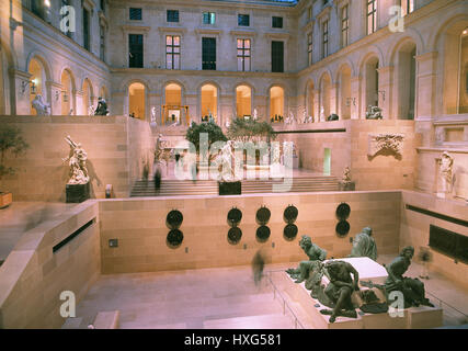 The Cour Puget of Richelieu Wing of the Louvre Museum.The Group of sculpture'The Four Captives'(Four Defeated Nations) - Stock Photo