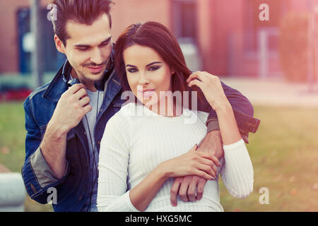 Happy trendy young coucasian couple in romantic moments outdoor vintage - Stock Photo