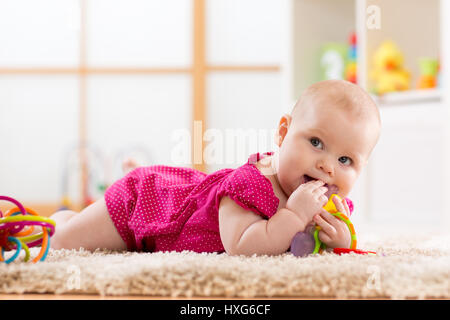 Baby chewing on teething toy - Stock Photo