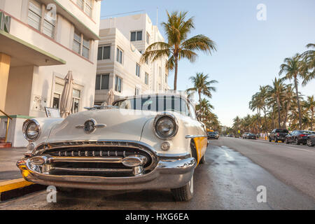 MIAMI, USA - MAR 10, 2017: Vintage american car parked at the famous Art Deco hotels in the Ocean Drive in Miami - Stock Photo
