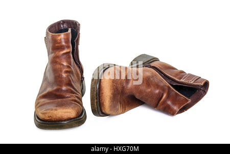 A pair of old winter boots on white. - Stock Photo