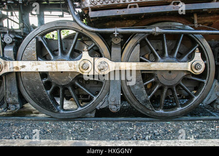 Close-up view of locomotive coupling rods. - Stock Photo