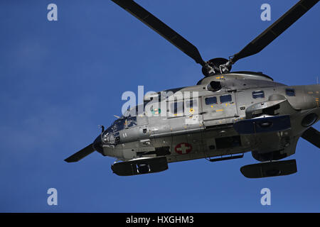 Locarno Airport,Ticino, Switzerland; March 27, 2017: a Swiss Air Force military Eurocopter AS332 Super Puma helicopter - Stock Photo