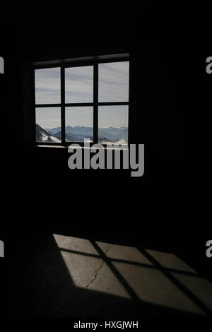 View of Mountain Landscape surrounding Mont Blanc through a window with the light falling on to the floor of the - Stock Photo