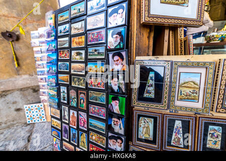 Magnets with Ali Khamenei and Ruhollah Khomeini portraits for sale on Bazaar of Isfahan next to Naqsh-e Jahan Square - Stock Photo