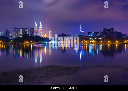 Kuala Lumpur skyline at night as seen from Titiwangsa Lakes, Kuala Lumpur, Malaysia - Stock Photo
