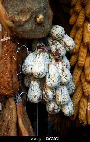 Traditional Norcineria shop selling Norcia salamis, Norcia, Umbria, Italy - Stock Photo