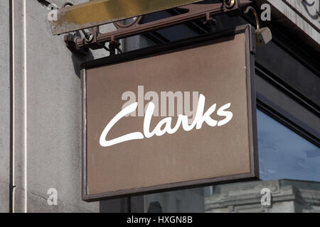 London, UK, February 27, 2011 : Clarks logo advertising sign outside one of its shoe stores in the city centre - Stock Photo