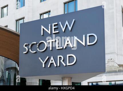 Revolving sign outside the Metropolitan Police headquarters at New Scotland Yard, Victoria Embankment, London, England, - Stock Photo