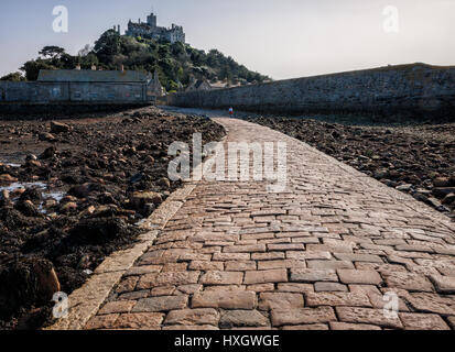 Granite pavement used only at low tide to walk to the island of St Michael's Mount from Marazion  in Mount's Bay - Stock Photo