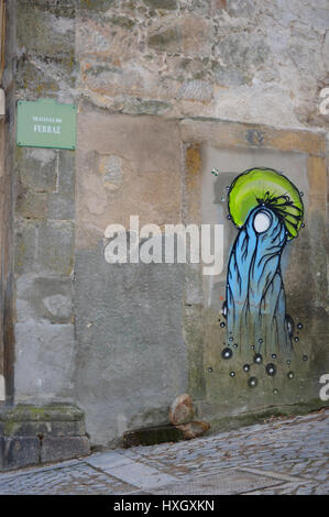 Street Art graffiti on a wall in Porto in 2017, Portugal - Stock Photo