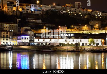 View over the Duoro River to Avenida de Diogo Leite at night in Porto, night cityscape, Portugal - Stock Photo