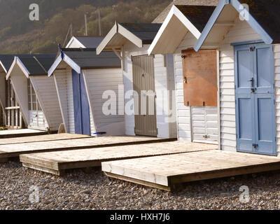 Row of pretty beach huts - Stock Photo