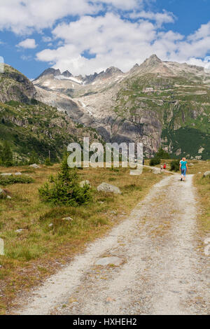 Walking towards the Rhône Glacier - Stock Photo