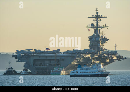 USS Theodore Roosevelt (CVN71) at anchor in The Solent, UK. - Stock Photo