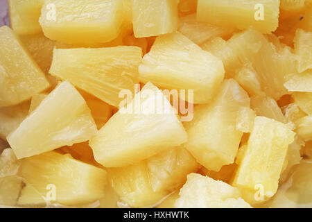 Pineapple slices as background. Yellow pineapples texture pattern. - Stock Photo