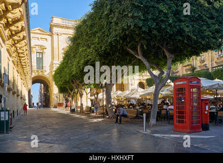 VALLETTA, MALTA - JULY 24, 2015: The view of the Old Theatre Street with the outdoor cafe full of people in the - Stock Photo