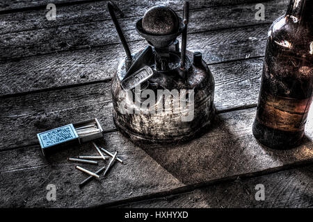 Old antique kerosene burner isolated on a white background - Stock Photo