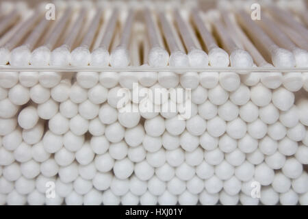 Cotton buds in box on blue background - Stock Photo