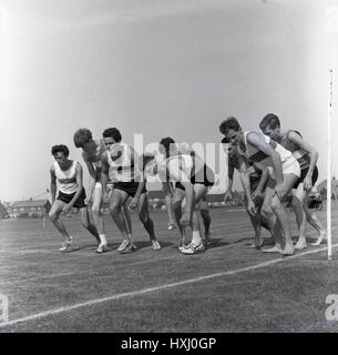 bare foo1960s, historical, young male athletes, some in bare feet, line up for the start of a outdoor running race - Stock Photo