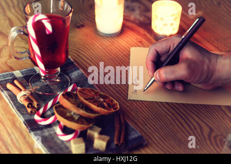 christmas hand writing story - Stock Photo