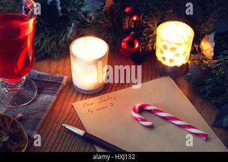 Christmas letter on the table with spices - Stock Photo