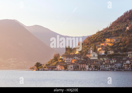The town of Peschiera Maraglio during a winter sunset, Brescia Province, Iseo Lake, Lombardy, Italy. - Stock Photo