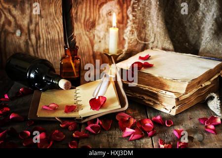 book pen candle romance - Stock Photo