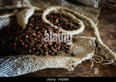 coffee bean on textile background - Stock Photo