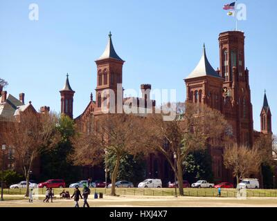 Smithsonian Institution Building under a clear blue sky,  viewed from the National Mall. Washington, DC, USA - Stock Photo