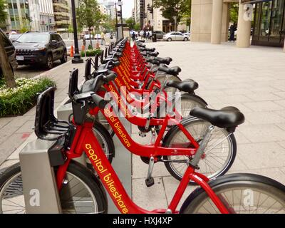 Red bicycles lined up for rent in the Foggy Bottom area of Washington, DC, USA. - Stock Photo