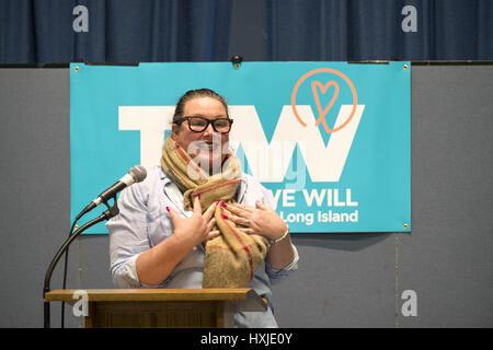 Wyandanch, New York, USA. 26th Mar, 2017. LAUREN CORCORAN-DOOLIN, Democratic Leader, Town of Hempstead, is speaking - Stock Photo