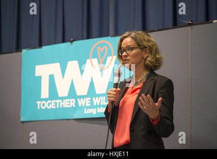 Wyandanch, New York, USA. 26th Mar, 2017. LAURA CURRAN, Nassau County Legislator (Democrat - District 5) speaks - Stock Photo