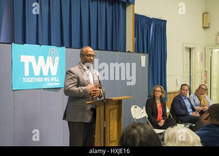 Wyandanch, New York, USA. 26th Mar, 2017. At podium, DuWAYNE GREGORY, Presiding Officer and Suffolk County Legislator - Stock Photo