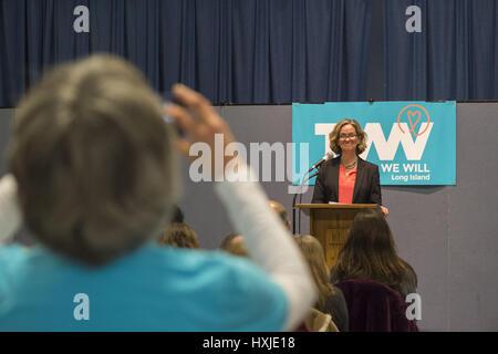 Wyandanch, New York, USA. 26th Mar, 2017. At podium, LAURA CURRAN, Nassau County Legislator (Dem - District 5) speaks - Stock Photo