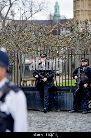 London, UK. 29th Mar, 2017. Armed police at the Houses of Parliament in Westminster today a week after Khalid Masood - Stock Photo