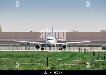 milan, Italy - March 29th, 2017: A commercial airplane takes off from Milan's Linate airport. Linate is a main hub - Stock Photo