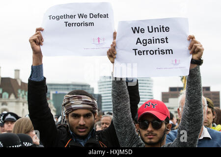 London, UK. 29th March, 2017. Members of the Muslim community on Westminster Bridge during a tribute by the Metropolitan - Stock Photo