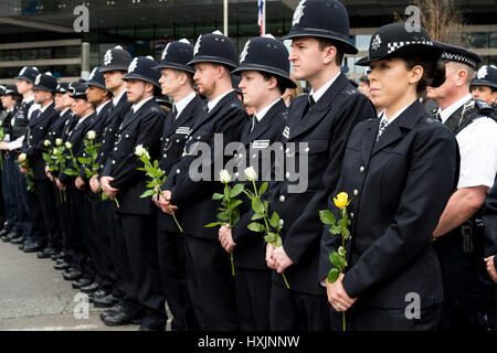 London, UK. 29th Mar, 2017. Police officers attend an event on Westminster Bridge to commemorate the victims of - Stock Photo